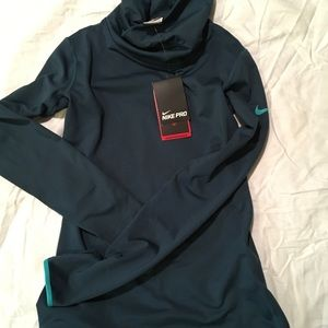 Nike Dri fit  turtleneck teal top. Size small NWT